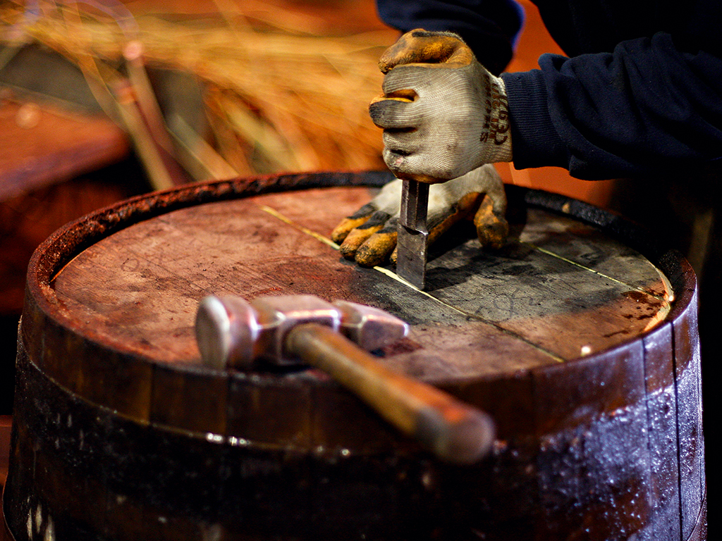 Cooper working on a cask with tools